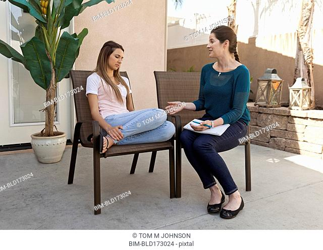 Caucasian woman talking with therapist in therapy