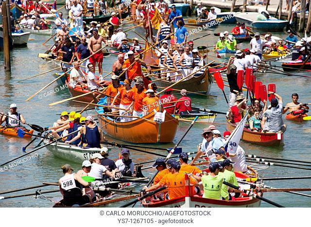 Boat procession during Vogalonga boat race, Venice, Italy
