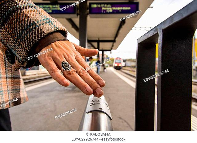 Braille writing on the handrail of the platform helps people to navigate and to choose the right train in Glattbrugg, Switzerland