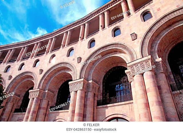 Facade of historic building with architectural details, arches and columns in center of Yerevan, Armenia