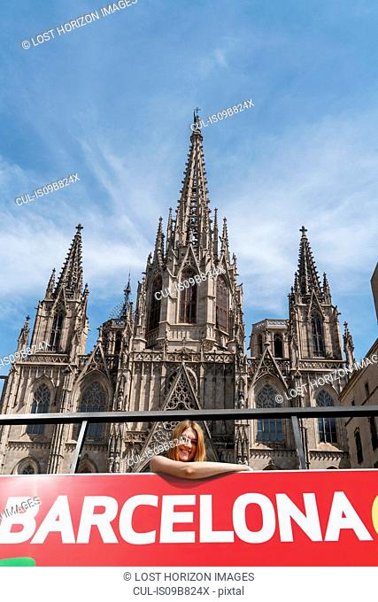 Woman on open top bus in front of Barcelona Cathedral, Barcelona, Catalonia, Spain, Europe