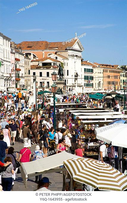 Stalls and shops along the Lagoon waterfront in Venice Italy