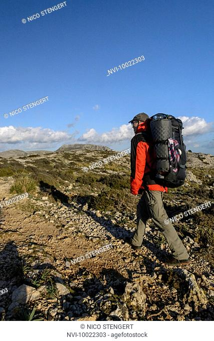 Hiker on the long distance footpath GR 221 between Valldemossa and Deia, Majorca, Spain
