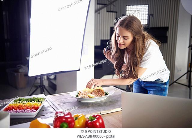 Blogger arranging food for a photo