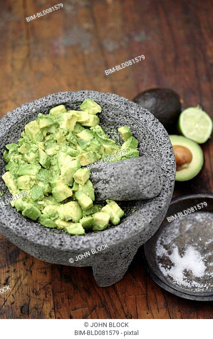 Guacamole in mortar with pestle