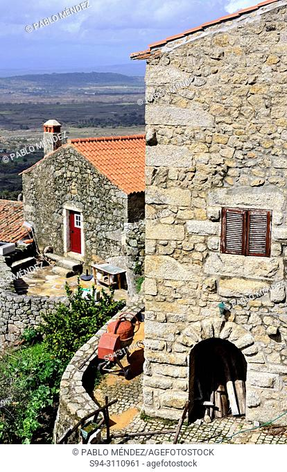 View of a stone house and the rooves of Monsanto, Castelo Branco, Portugal