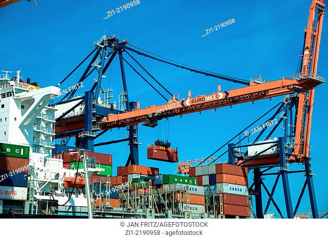 containership with crane at the harbour of Rotterdam, Europoort, the Netherlands