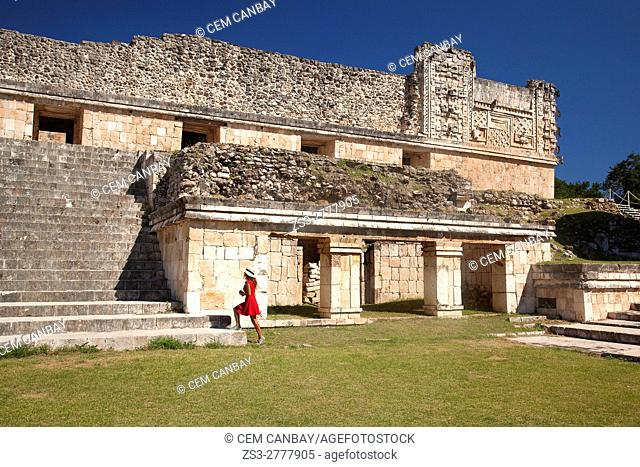 Tourist woman in front of the Quadrangle Of The Nuns in Uxmal Ruins, Uxmal, Yucatan Province, Mexico, Central America
