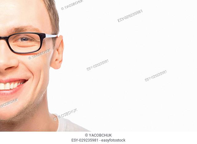 Smiling guy in glasses. Young guy wearing transparent glasses
