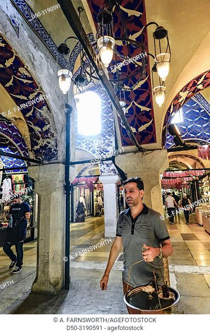 Istanbul, Turkey A man carries tea in the Grand Bazaar