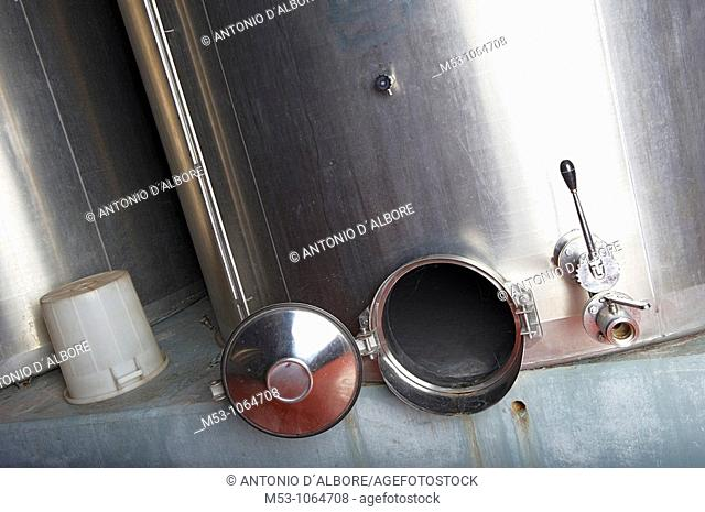 Large empty stainless steel tank used in agricolture for wine storage