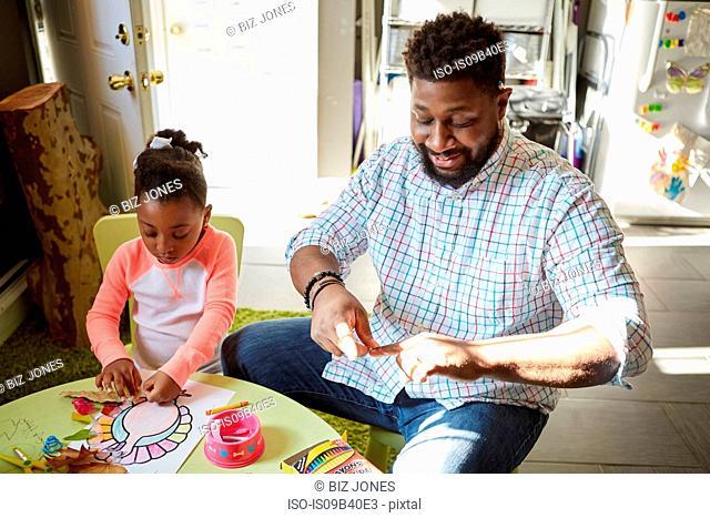 Father and daughter enjoying handicraft activity