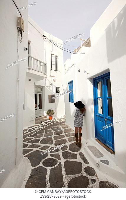 Woman in the alleys of town center, Mykonos, Cyclades Islands, Greek Islands, Greece, Europe