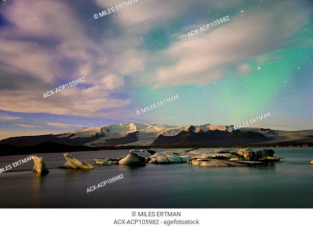 Aurora (Northern Lights) over Hvannadalshnukur Peak at Jokulsarlon Glacial Lagoon, Iceland