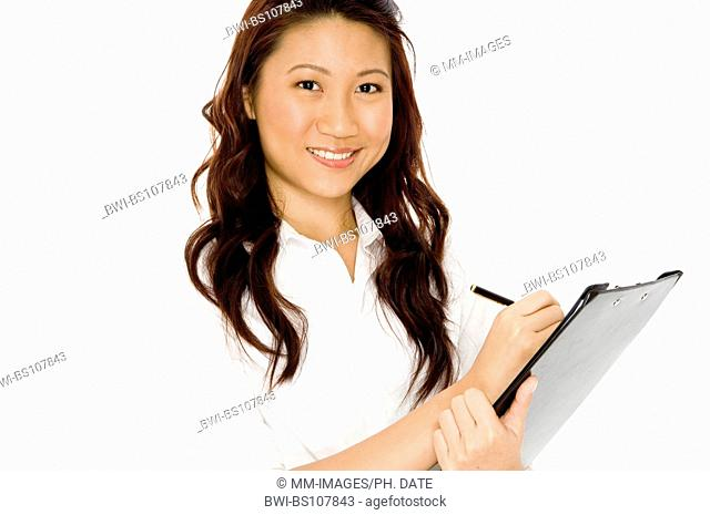 A pretty young asian businesswoman with file on white background