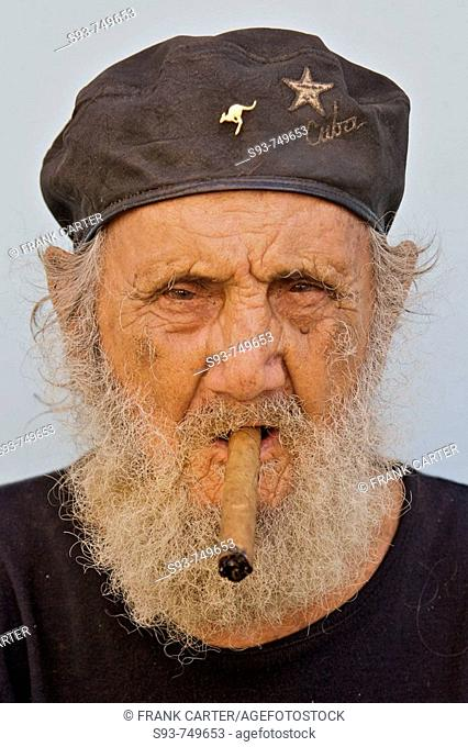 d3f4b72ca33fb An old Cuban man wearing a beret and smoking a cigar