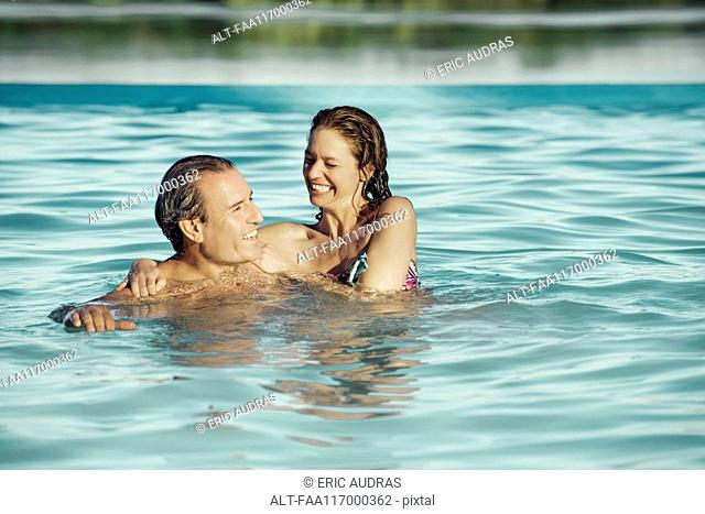 Couple enjoying in swimming pool
