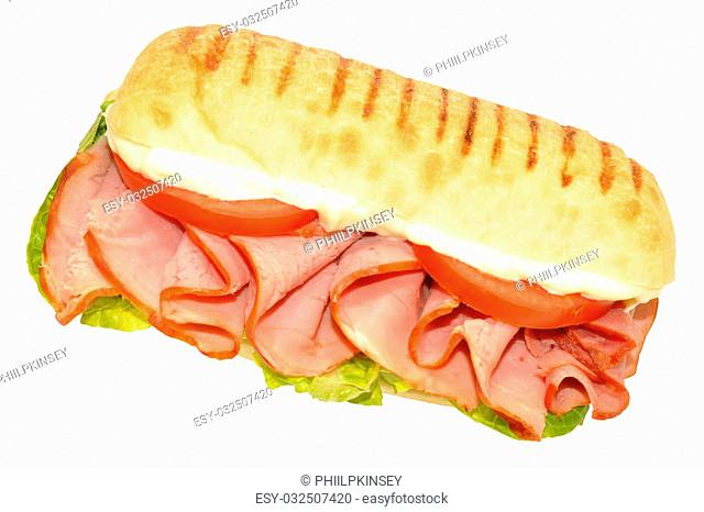 Smoked ham sandwich on a Panini bread roll isolated on a white background