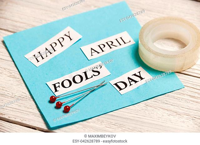 Happy April Fools Day phrase on wooden background