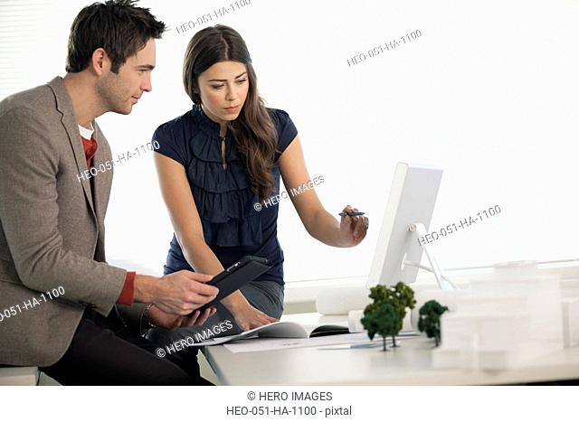 coworkers reviewing architectural plans