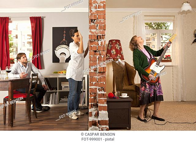 A split screen showing an angry woman pounding on the wall to her neighbor