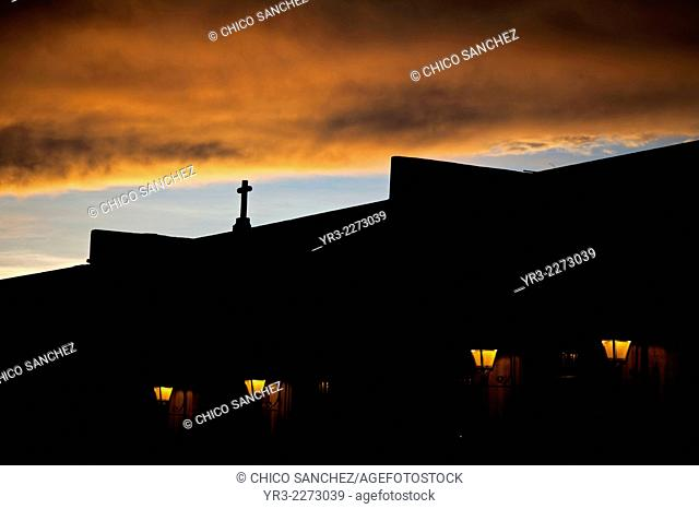 Silhouette of a cross decorating a cross in a colonial building at sunset in Queretaro, Mexico