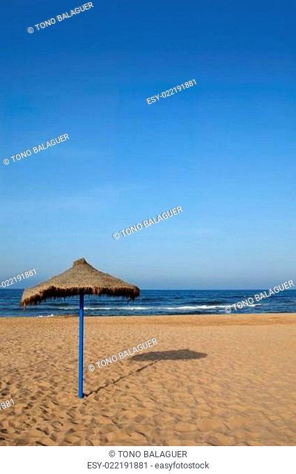 Summer vegetal beach heater wattle umbrella blue sea sky