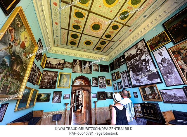 Visitors look at works of art of German renaissance painters Lucas Cranach the older (1472-1553) and his son Lucas Cranach the younger (1515-1586) at the...