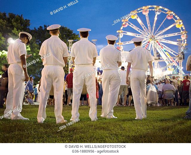 U S  Navy sailors at the carnival at the Maine Lobster Festival in Rockland, Maine, United States