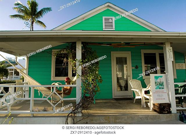 Typical loyalist house, Hope Town, Elbow Cay, Abacos. Bahamas. Relaxing in a hammock