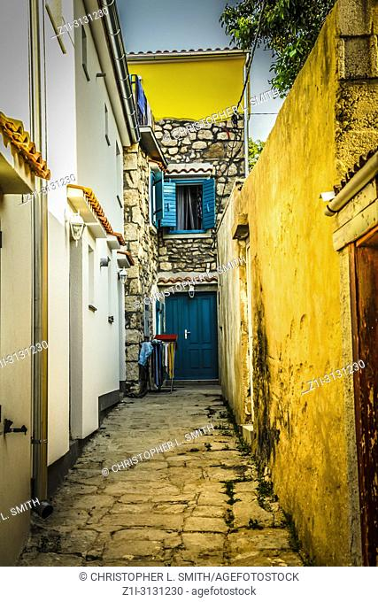Croatian homes along narrow streets in the small fishing village of Baska on the island of Krk in the Adriatic
