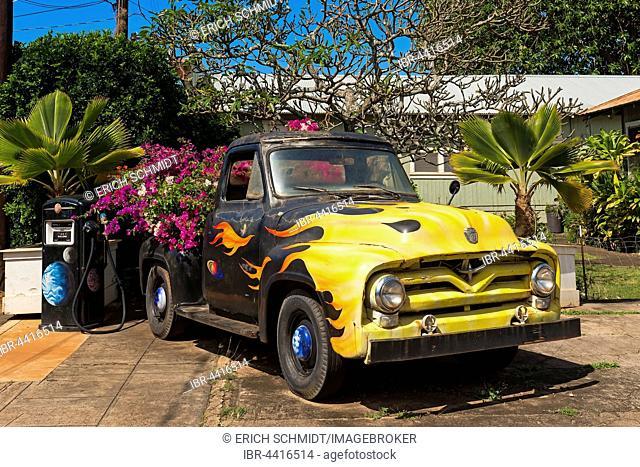 Vintage car decorated with flowers, old petrol station, Eleele, Kauai Island, Hawaii