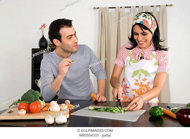 Couple preparing vegetables in the kitchen