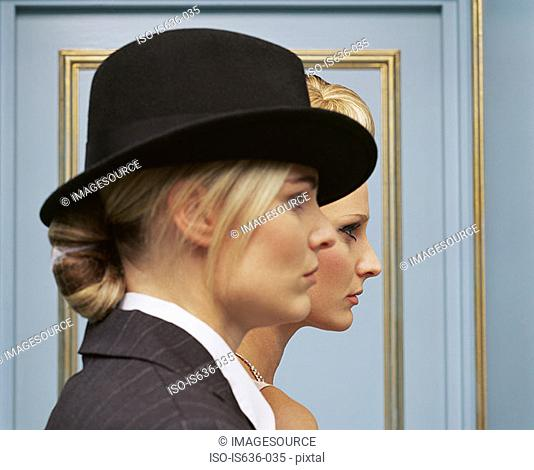 Two women one wearing a trilby