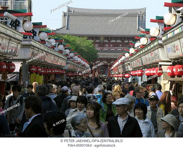 People crowd a touristic street leading to the Asakusa Senso-ji, a Buddhist temple, in Tokyo, Japan, 23 April 2013. The shrine was built in 1649 and is one of...