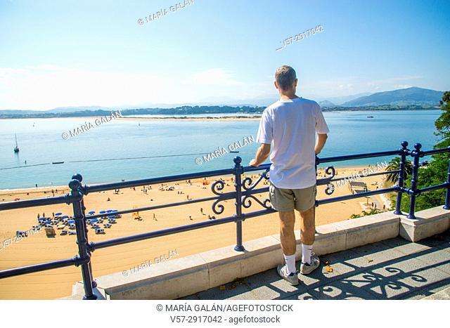 Man at the viewpoint over the bay and La Magdalena beach. Santander, Spain