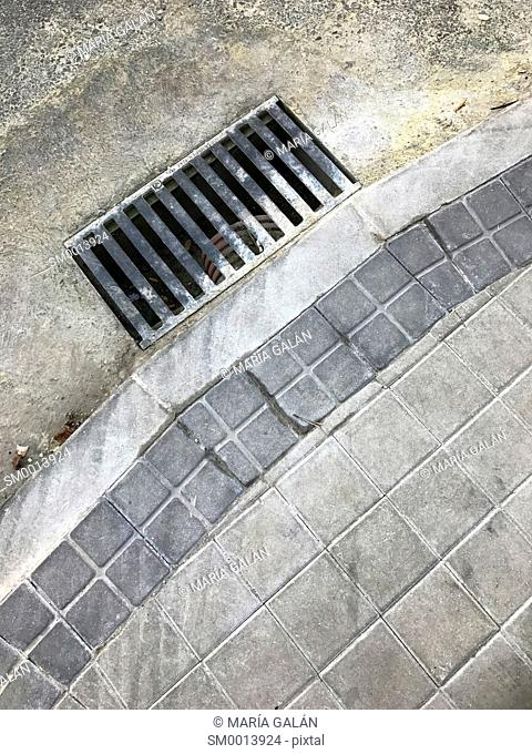 Sewer drain and pavement of street