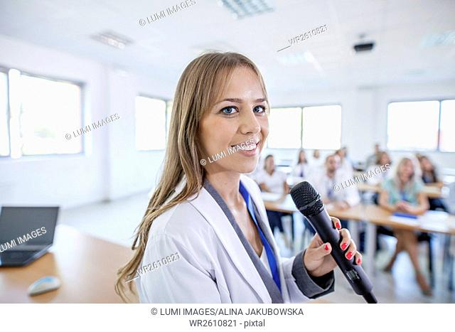 Female doctor giving presentation in training class