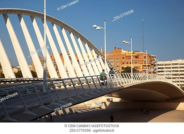 People walking on the Pont de l'Exposicion' La Peineta' or 'Alameda Bridge' by Santiago Calatrava, in Jardi del Turia gardens, Valencia, Spain, Europe