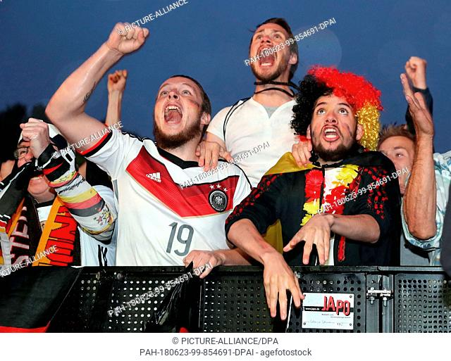 23 June 2018, Berlin, Germany: World Cup 2018, Football: Germany vs Sweden , Preliminary round, Group F, 2nd game day. Fans cheering after Germany's victory...