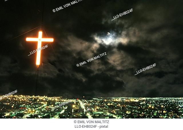 Illuminated Cross Over City Lights with Moon Shining Through Cloud  Bloemfontein, Free State Province, South Africa
