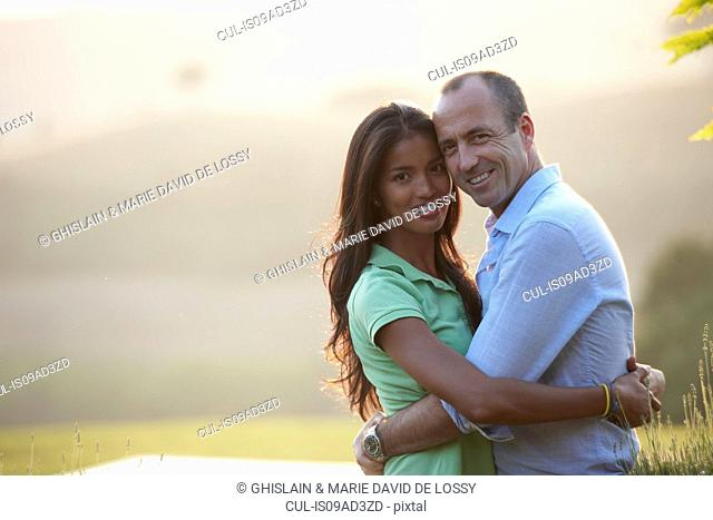 Couple posing for camera