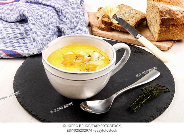 specialty from scotland, freshly cooked cullen skink with thyme in a mug on slate