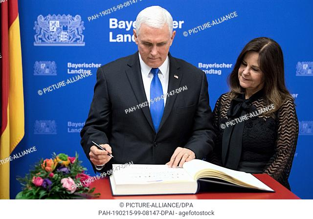 15 February 2019, Bavaria, München: Mike Pence, Vice President of the USA, and his wife Karen sign the Golden Book in the State Parliament before the award of...