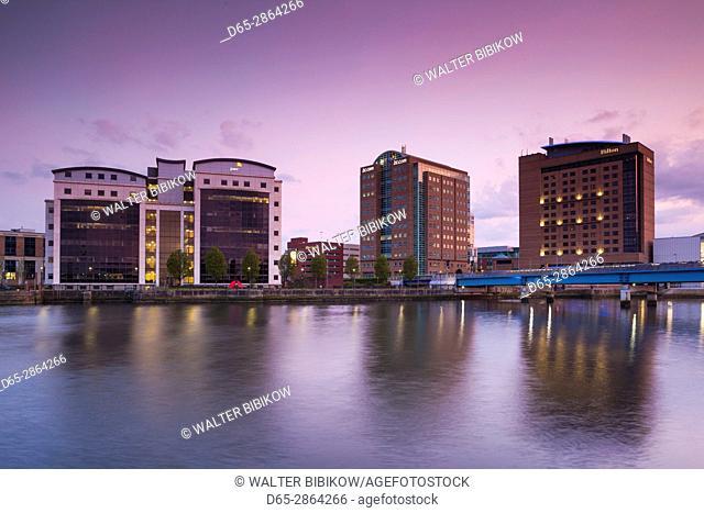 UK, Northern Ireland, Belfast, city skyline along River Lagan, dusk