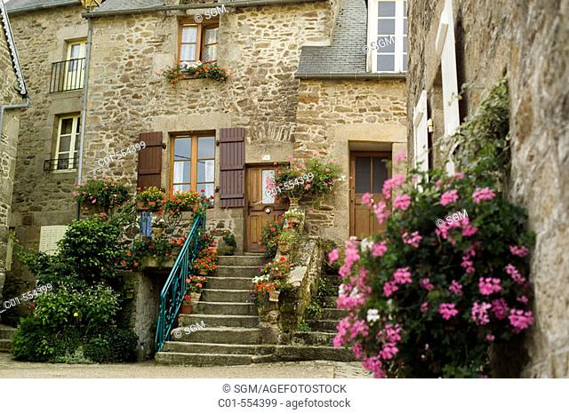 Houses with stairs and flowers. Léon, near Dinan. Britanny. France