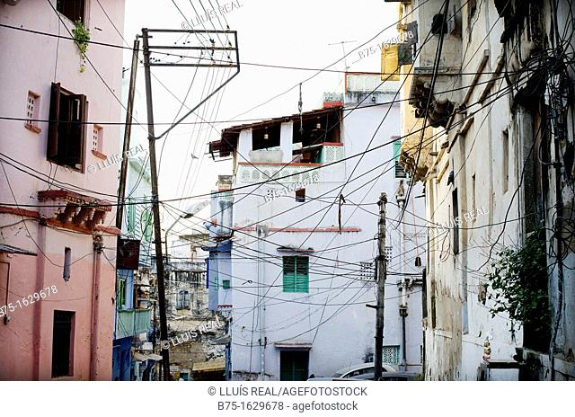 Typical view of a street in an Indian city with their buildings and electrical wires across the street, India, Asia
