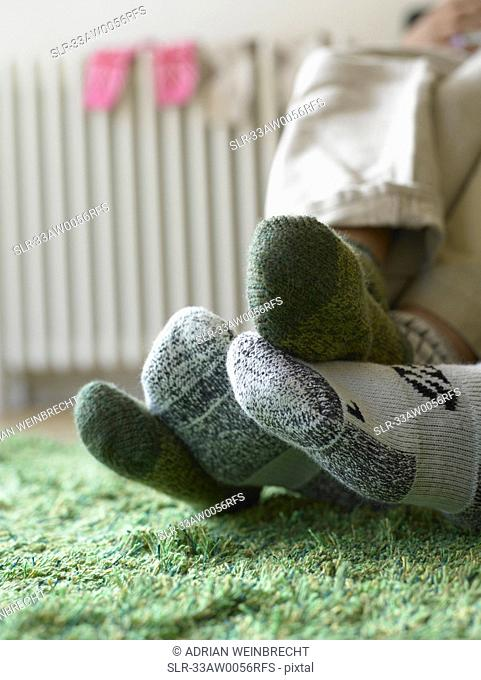 Close up of couple?s feet in socks