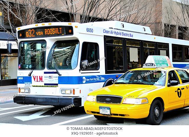 MTA Q32 Public Transportation bus exiting Queensboro 59th Street Bridge during evening rush hour, Midtown Manhattan, New York City