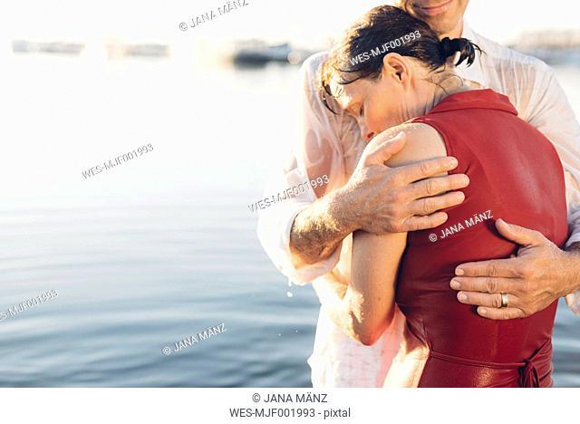 Couple embracing at lake